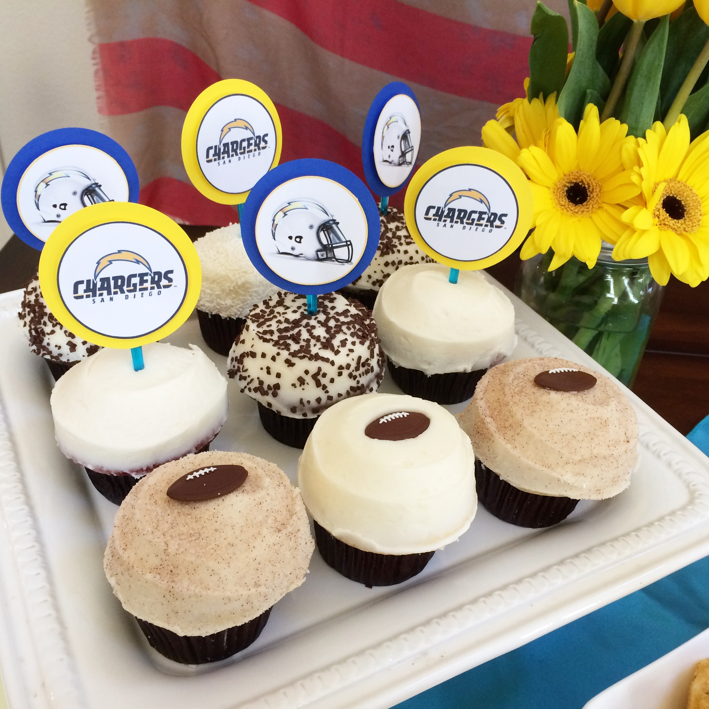 Chargers theme cupcakes. Go Bolts! Football cupcakes!